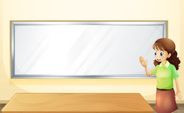 A teacher inside the room with an empty bulletin board Stock Photography