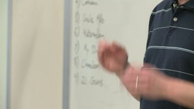Teacher instructing class (2 of 2). A view or scene of School stock video footage