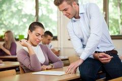 Teacher instructing student Stock Photos