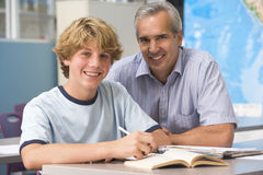 A teacher instructs a schoolboy Stock Image