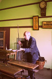 Teacher in Irish school in late 80s. Bunratty Castle and folk park in County Clare, Ireland. Recreation of old traditional school Stock Images