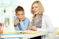Teacher and kid Royalty Free Stock Images