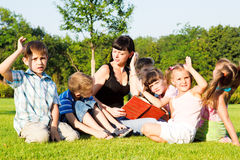 Teacher and kids Stock Images