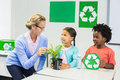 Teacher and kids discussing about recycle. In classroom Royalty Free Stock Photo