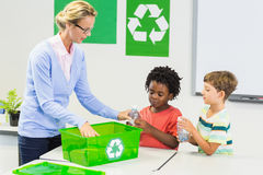 Teacher and kids discussing about recycle. In classroom Stock Image