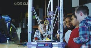 Teacher with kids exploring 3d printing stock video