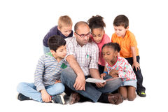 Teacher with kids Stock Images