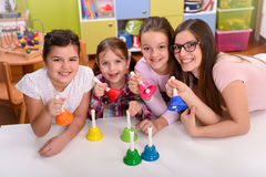 Teacher and Kids Holding Musical Hand  Bells. Music School Royalty Free Stock Photography