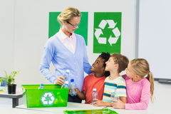 Teacher and kids interacting with each other in classroom. At school Stock Photography