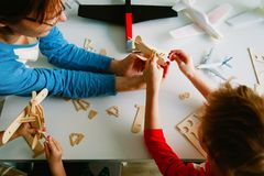 Teacher and kids making toy planes, learning concept. Teacher and kids make toy planes, engineering skills for kids, learning stock photos