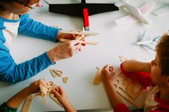 Teacher and kids making toy planes, learning concept. Teacher and kids make toy planes, engineering skills for kids, learning royalty free stock images