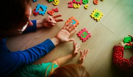 Teacher and kids play with number puzzle. Learn calculation royalty free stock image