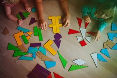 Teacher and kids play with puzzle, learn math. Teacher and kids playing with puzzle, education and learning concept royalty free stock photos