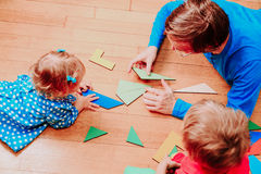 Teacher and kids playing with geometric shapes Stock Images