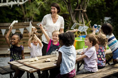 Teacher and kids school learning ecology gardening Stock Photography