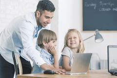 IT teacher with kids stock photos