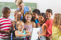 Teacher and kids using digital tablet Stock Photos