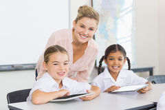 Teacher and kids using digital tablet. In classroom at school Stock Photography