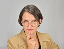 Teacher lady. Picture of a teacher lady with with glasses posing Stock Photography