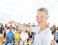 Teacher and large group of student in Lecture room Royalty Free Stock Images