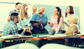 Teacher laughing with students Royalty Free Stock Images