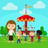Teacher leads children in kindergarten Stock Images