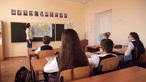 The teacher leads a geography lesson.  stock footage