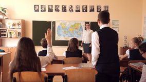 The teacher leads a geography lesson.  stock video footage