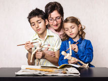 Teacher learning boy and girl paint class Stock Image
