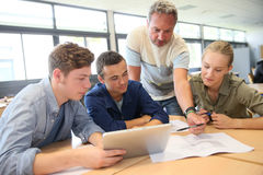 Teacher learning skills to group of students royalty free stock image