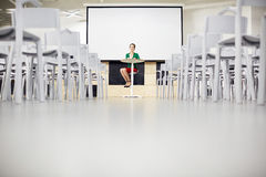 Teacher in lecture-room Stock Image