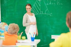 Teacher at lesson Stock Photo