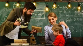 Teacher lets students know that they can depend not only on her, Teacher or tutor helps preschool child, In teachers. Classroom each persons ideas and opinions stock photography