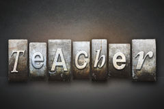 Teacher Letterpress. The word TEACHER written in vintage letterpress type stock photography