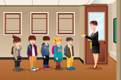 Teacher lining up the students. A vector illustration of teacher lining up the students in front of the classroom Stock Images