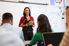 Teacher listening to students at an adult education class Stock Photo