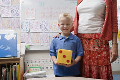 Teacher With Little Boy Holding Large Dice Royalty Free Stock Photo