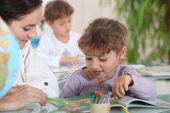 Teacher with a little girl Royalty Free Stock Images
