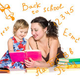 Teacher with little girl Stock Photography