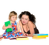 Teacher with little girl Stock Images