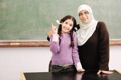 Teacher and little girl Stock Images