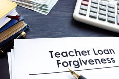 Teacher Loan Forgiveness documents on a table. Teacher Loan Forgiveness documents on the table royalty free stock image