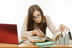 Teacher looking for information in a book Stock Photos