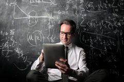 Teacher looking at ipad royalty free stock photos