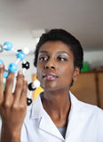 Teacher Looking At Molecular Structure In Science Stock Image