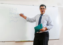 The teacher looks into the classroom and smiles Royalty Free Stock Photos