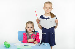 The teacher looks at the student blog Stock Photo
