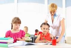 Teacher makes the lessons. With their children in school Stock Images