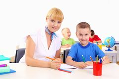 Teacher makes the lessons. With their children in school Stock Photography