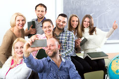 Teacher making selfie with students stock image